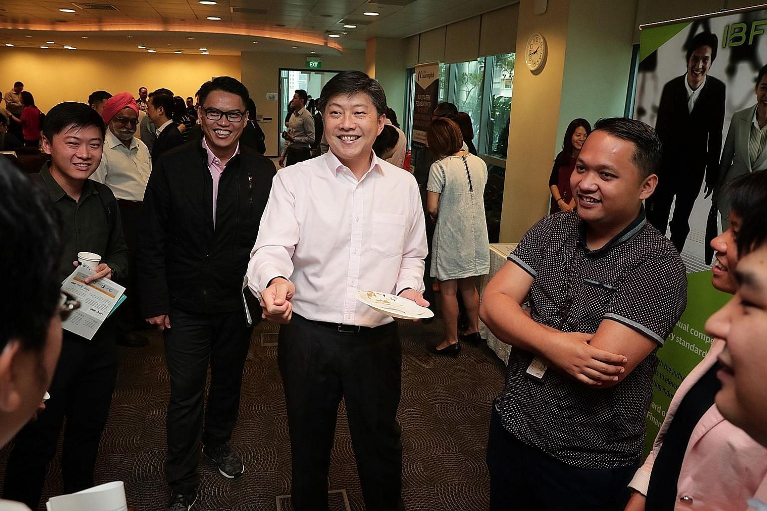 NTUC secretary-general Ng Chee Meng (centre) and assistant secretary-general Patrick Tay (in black jacket) before the start of the Future Jobs, Skills and Training Forum yesterday.