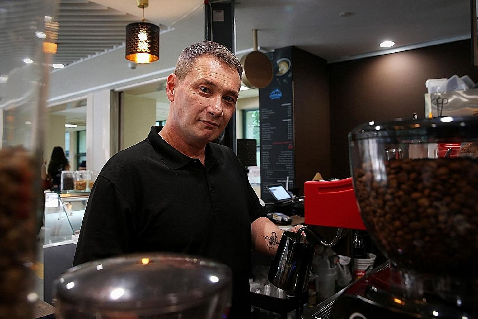 Mr Bruce Mathieu is a former drug offender who now works at The Caffeine Experience, a social enterprise that hires ex-offenders. A tattoo on his left forearm has his daughter's name, Beatrix, on it. It serves as a reminder to him to stay clean, as h