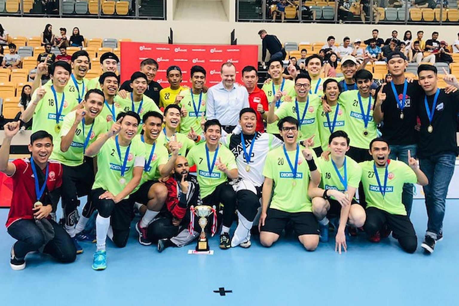 Tomas Eriksson, president of the International Floorball Federation, posing with victorious Victoria School players at Our Tampines Hub yesterday. The ActiveSG-Singapore Floorball Association (SFA) Men's Premier League closed on a high note as close