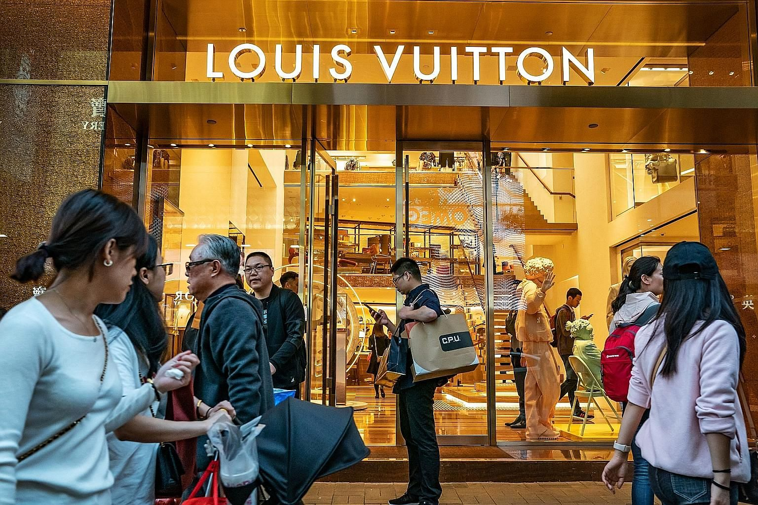 Paris-based luxury giant LVMH, which owns Louis Vuitton, is among the consumer companies still upbeat about business in China despite warnings of a softening economy from other multinationals operating in the country. Across 195 fourth-quarter earnin