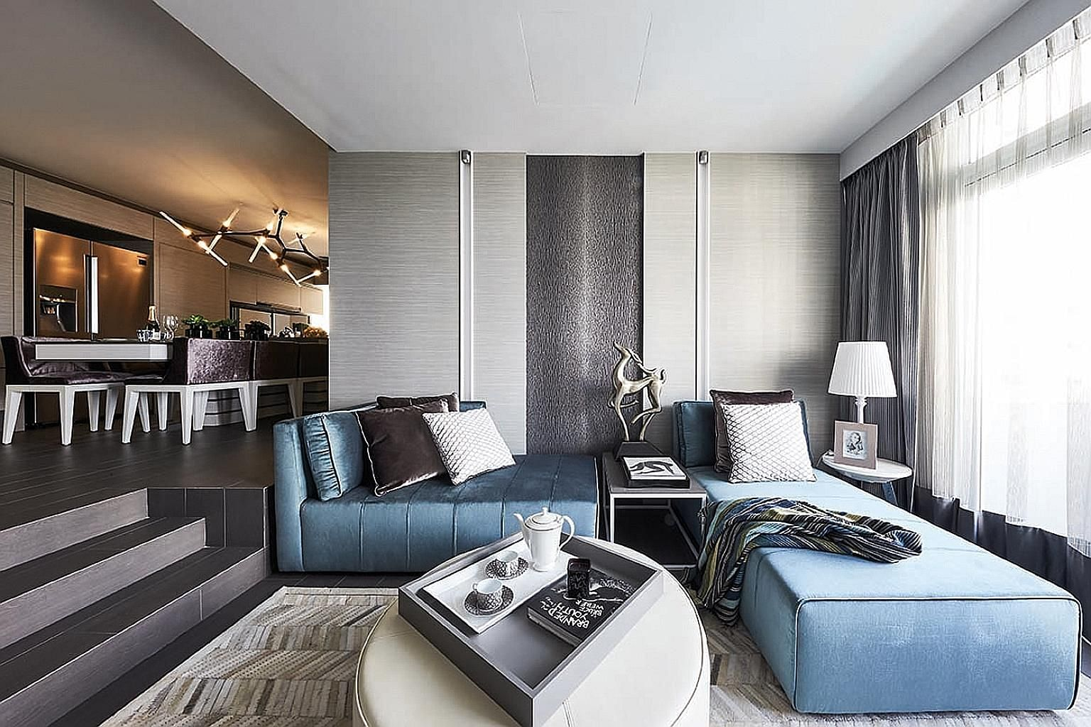 In this bedroom, most of the wall space has been turned into stylishly concealed storage. The guest room's built-in storage is wrapped around the daybed, which is the space's centrepiece and is enhanced by the feature wall. The bathtub that was previ