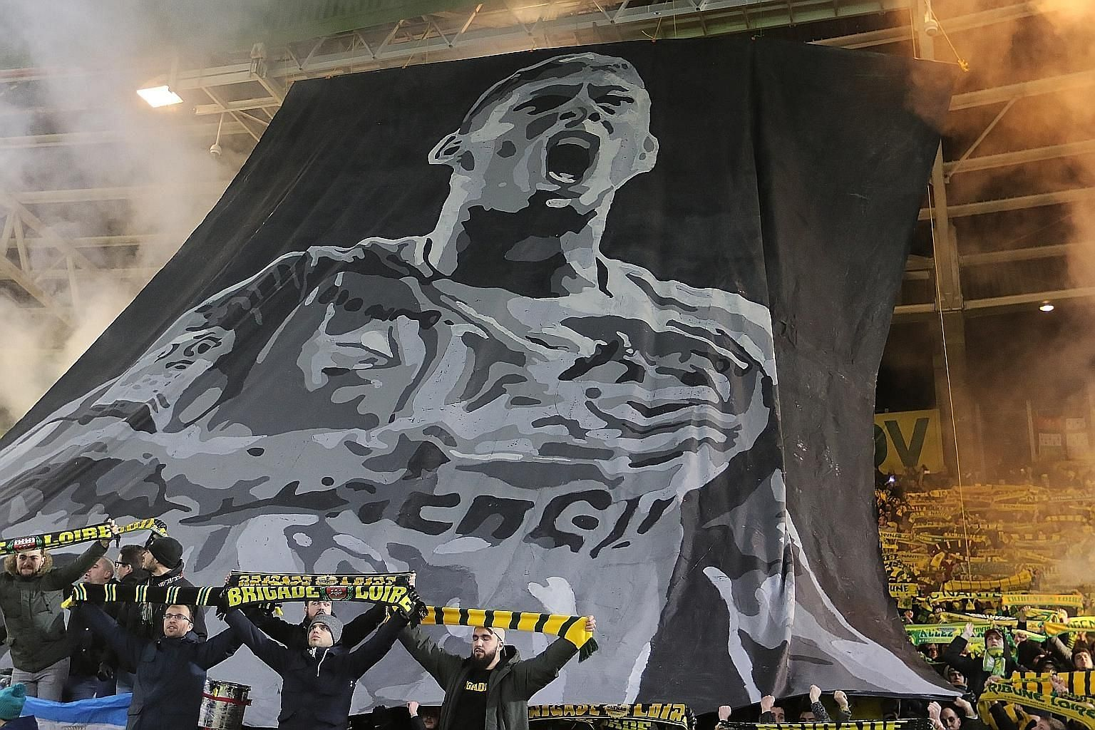 Nantes supporters displaying a banner in tribute to Emiliano Sala ahead of a French Ligue One match at the club's stadium last month. After his body was identified, there was also an outpouring of grief from fellow footballers, many of whom paid trib