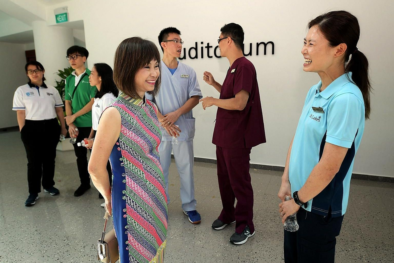 Senior Minister of State for Health Amy Khor speaking to Ms Angela Huang, who successfully made a mid-career switch to become a physiotherapist, at the launch of the new degree programme at Singapore Institute of Technology yesterday.