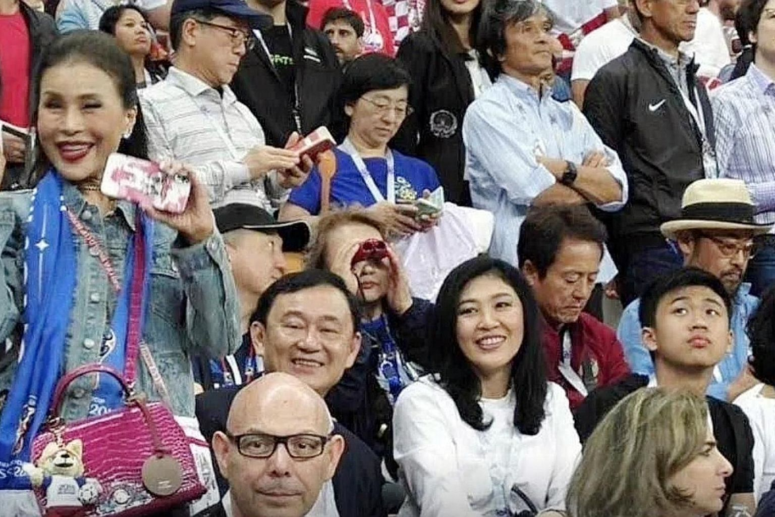 Former princess Ubolratana Rajakanya (left, standing) at a World Cup match in Russia last year with Thaksin Shinawatra and his sister Yingluck, both of whom are former prime ministers of Thailand who fled the country to avoid jail terms. Ms Ubolratan