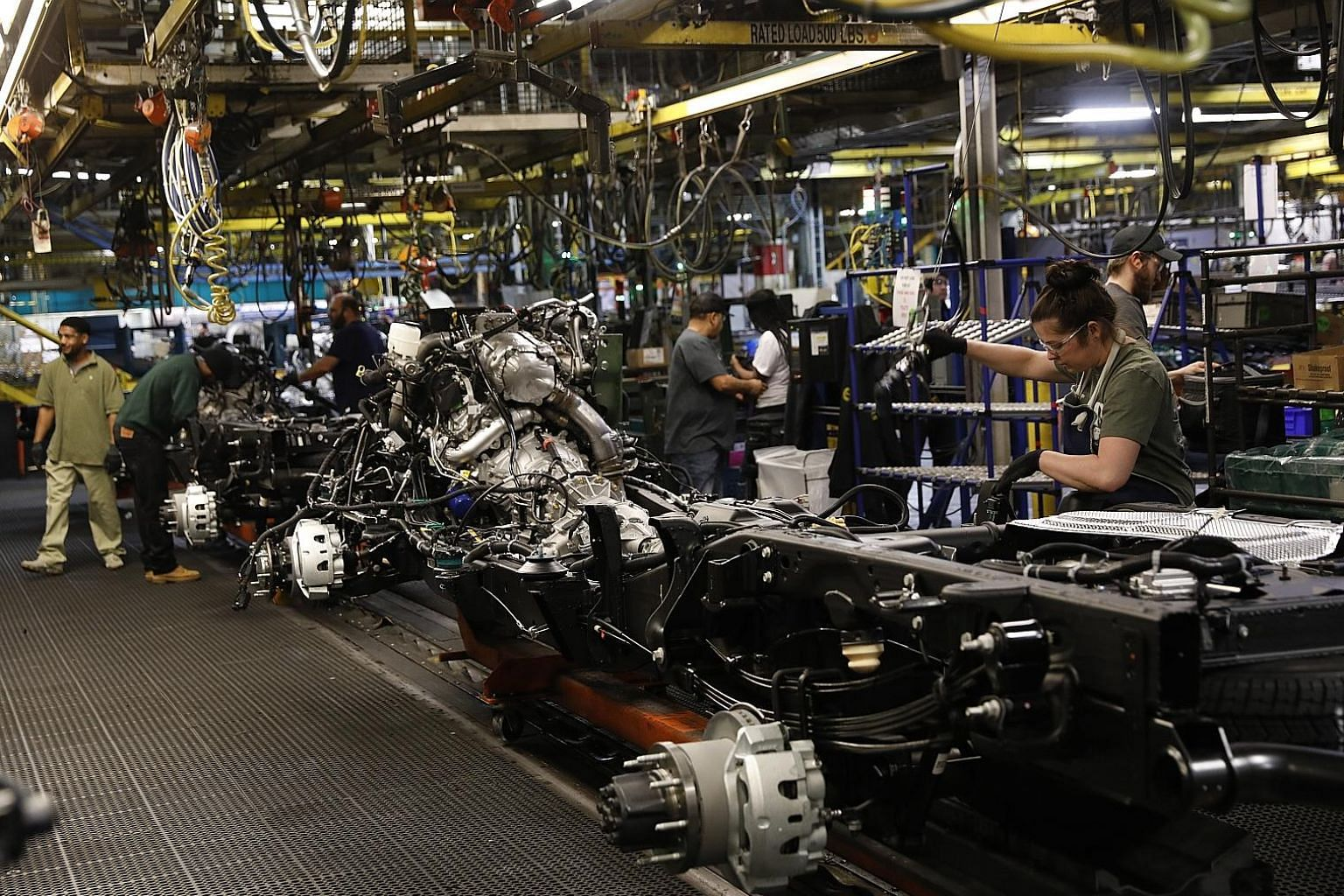 A General Motors plant in the US. Automation is changing the nature of work, flushing workers without a college degree out of productive industries, like manufacturing and high-tech services, and into tasks with meagre wages and no prospect for advan