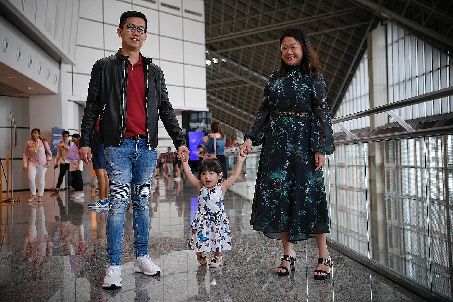 Ms Lin Xiu Zhen and her husband Ivan Yeo with their daughter Zara, two, whom they adopted from Malaysia when she was one month old. About 30 per cent of the adoption applications in the past five years involved Singaporean children - the rest were mo
