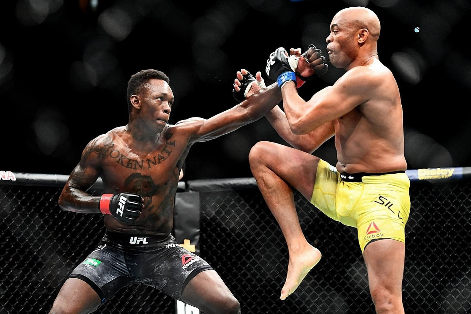 Israel Adesanya throwing a punch at Anderson Silva in their fight, which he won by unanimous decision.