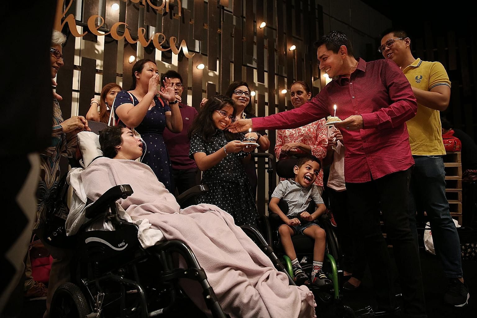 Mr Vishindas during a church worship service at Suntec City convention centre, as his mother-in-law Rani Sham Baharani watches over Madam Pooja. Mr Vishindas and Madam Kaur supporting Ryan, now six, on the monkey bars at the playground. Ryan suffered
