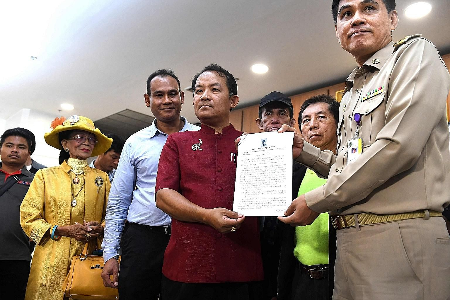 Mr Srisuwan Janya (centre) of the Association for the Protection of the Constitution with his petition to the election commission to dissolve the Thai Raksa Chart Party yesterday, saying its decision to nominate Princess Ubolratana Rajakanya as prime