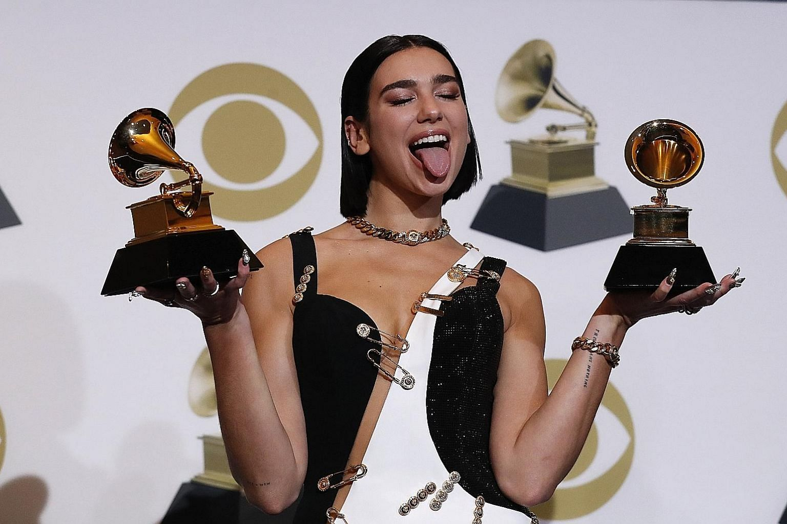 (Above) K-pop juggernauts BTS are the first South Korean act to present an award at the Grammys, while pop singer Camila Cabello (left, with singer Ricky Martin) makes history as the first Latin act to open the Grammys. Singer-songwriter Brandi Carli