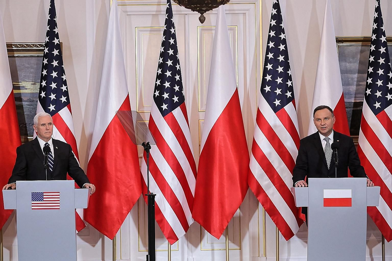 Polish President Andrzej Duda (far right) and US Vice-President Mike Pence addressing the press in Warsaw on Wednesday. Fuelled by concerns that Huawei products could be used by China for espionage, the US has been convincing its allies to exclude te