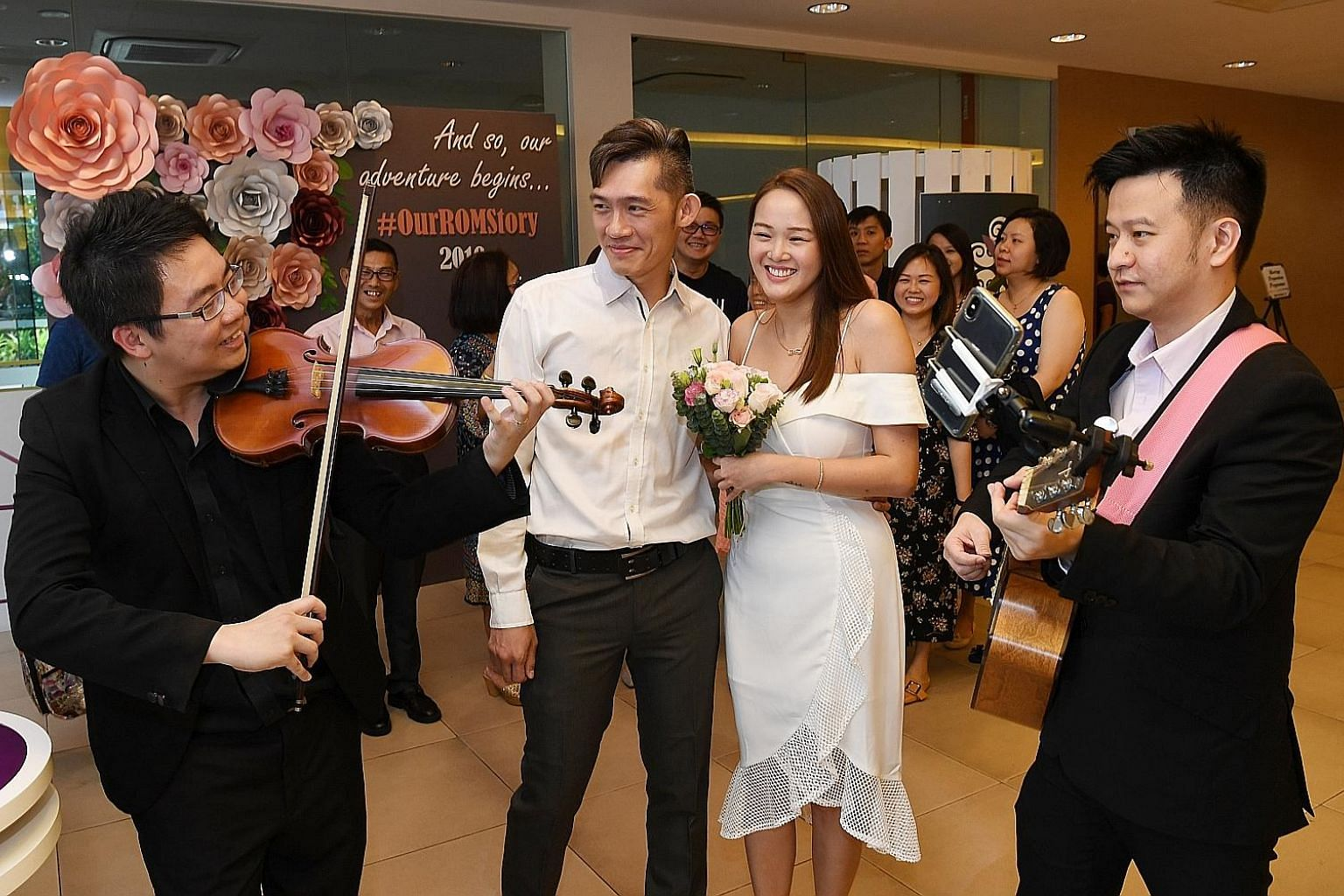 Love was in full bloom yesterday at the Registry of Marriages (ROM) as many couples chose to tie the knot on Valentine's Day, including (left) Mr Pang Sze Hou, 36, and Ms Wu Xuele, 28, and (below) Mr Suresh Naidu and Ms Suppiah Praba, both 35. ROM sa