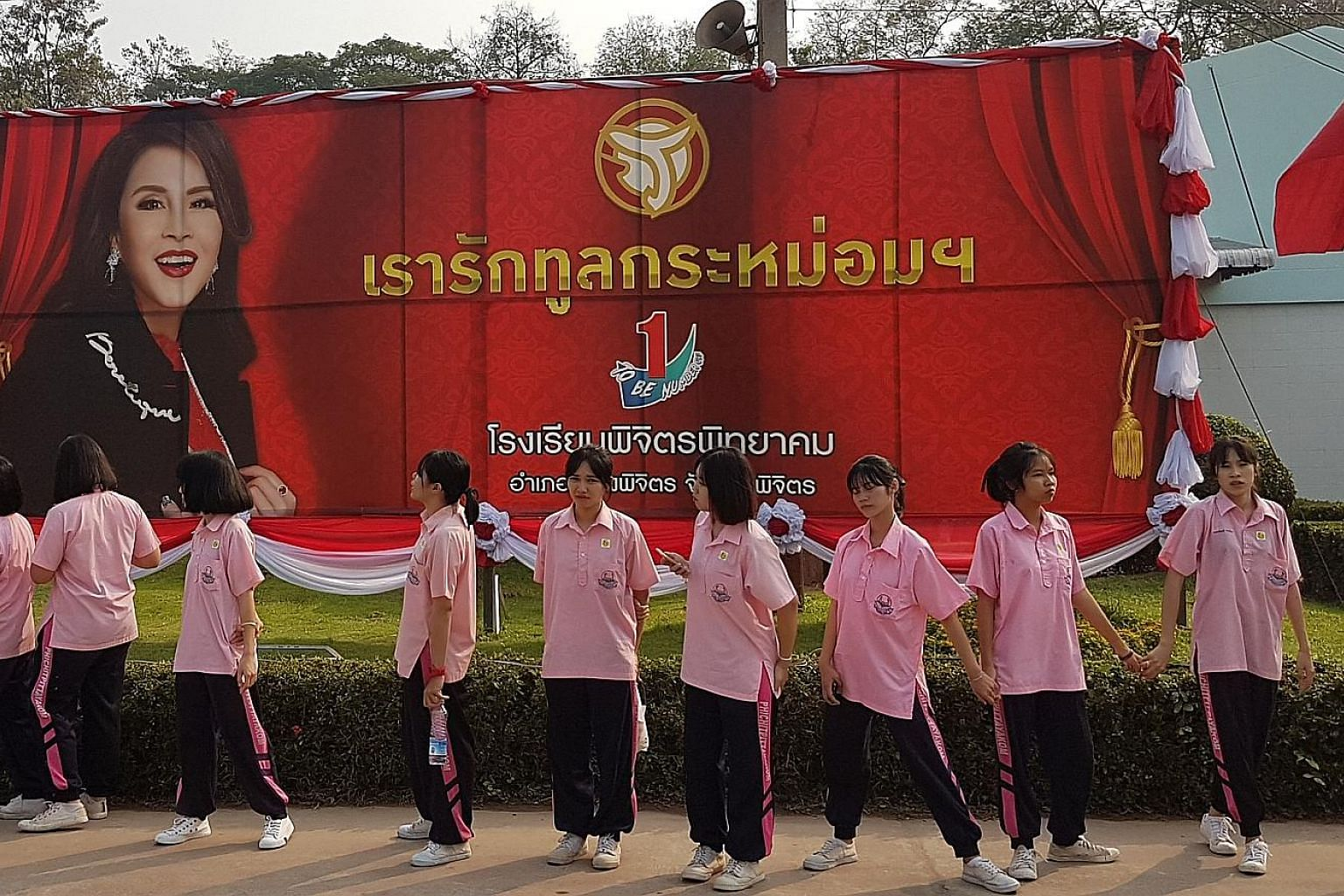 Students preparing for the arrival of Thai Princess Ubolratana Rajakanya on Thursday in Phichit Pittayakom school in Phichit Province. Thailand's Election Commission has dropped Princess Ubolratana from a list of nominees for prime minister for next