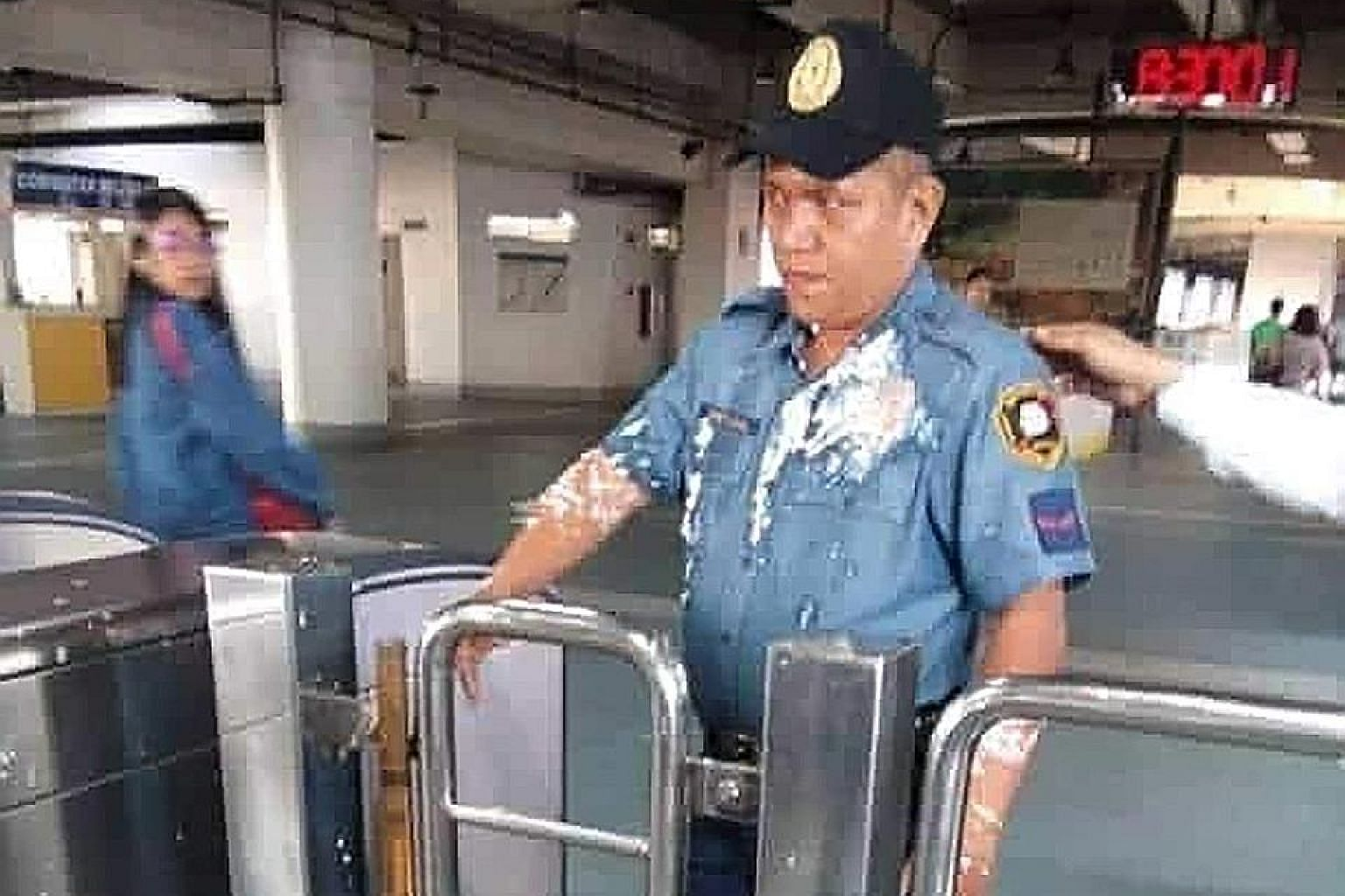 In the video clip, Zhang Jiale (above) came across as haughtily defiant as she glared across the turnstile at Officer William Cristobal with bean curd streaming down his shirt front and arm.