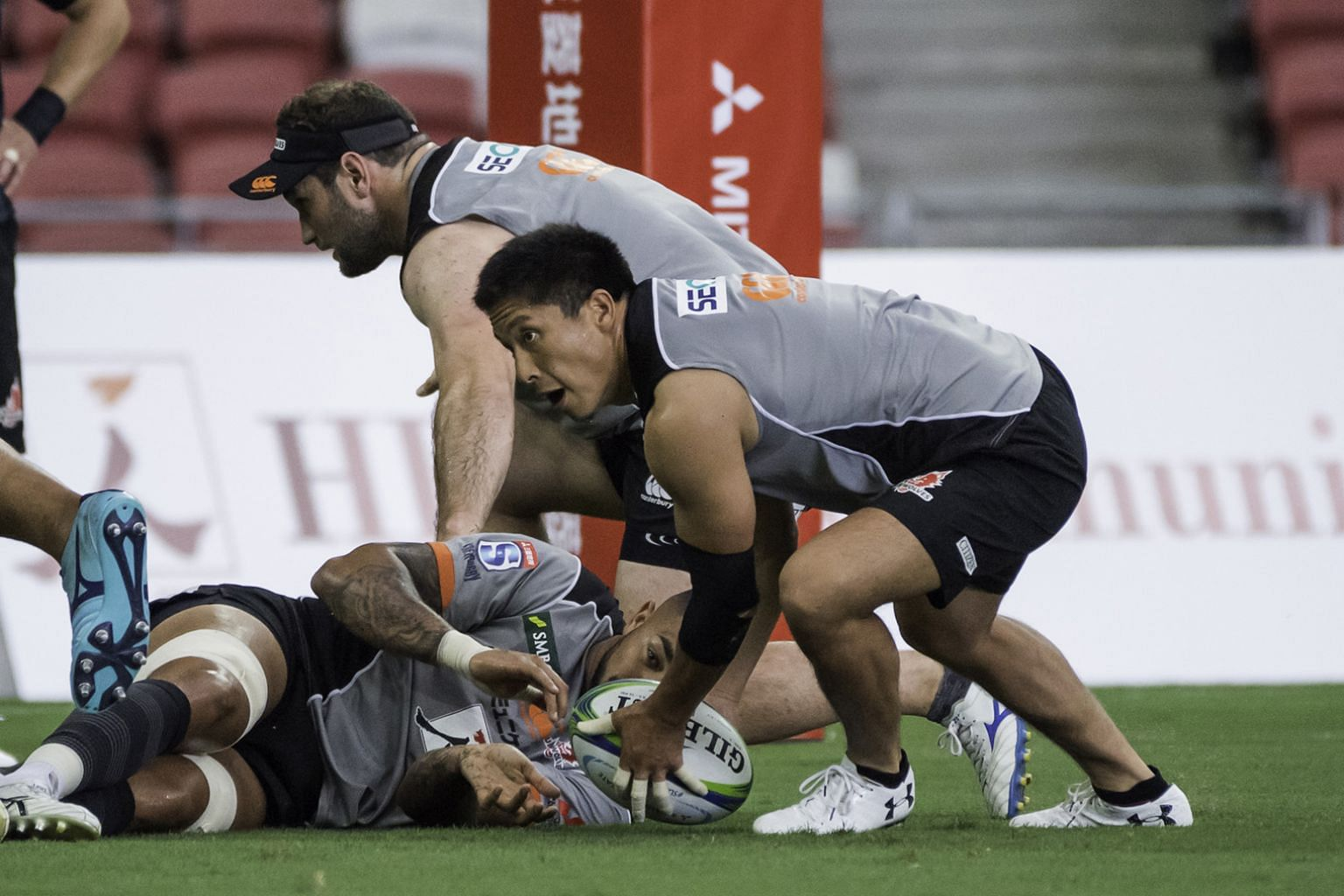 The Sunwolves players getting a feel of the National Stadium pitch yesterday. They will face the Sharks today in their opening game of the 2019 Super Rugby season.