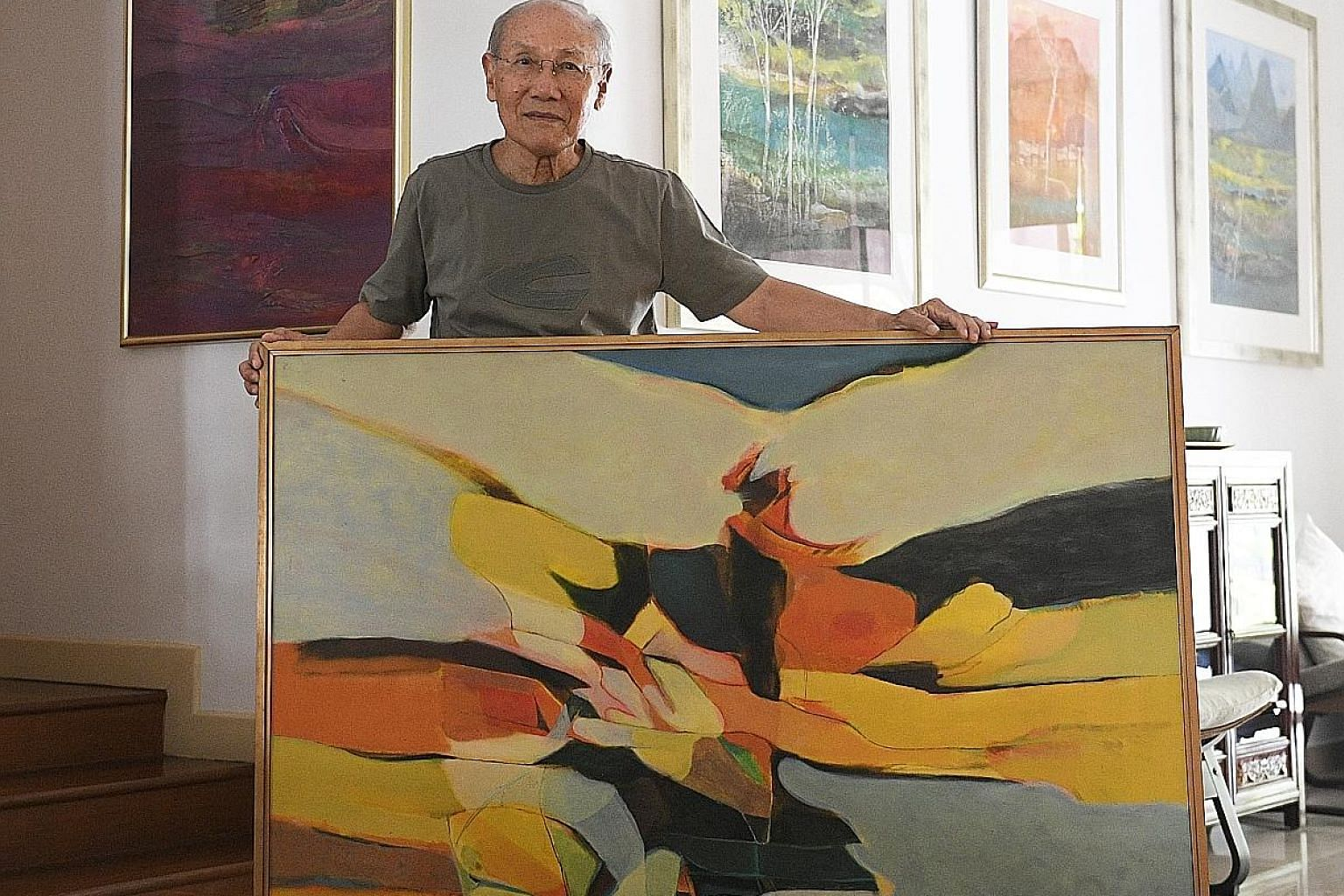 Artist Thomas Yeo at his home with his favourite artwork made in 1967 which is not for sale.