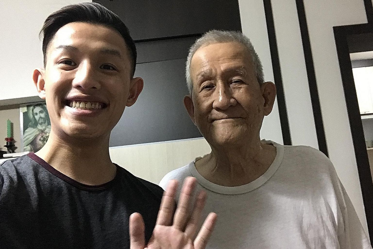 The writer with his grandfather in 2017. The elderly man emphasised the importance of genuine human connection.