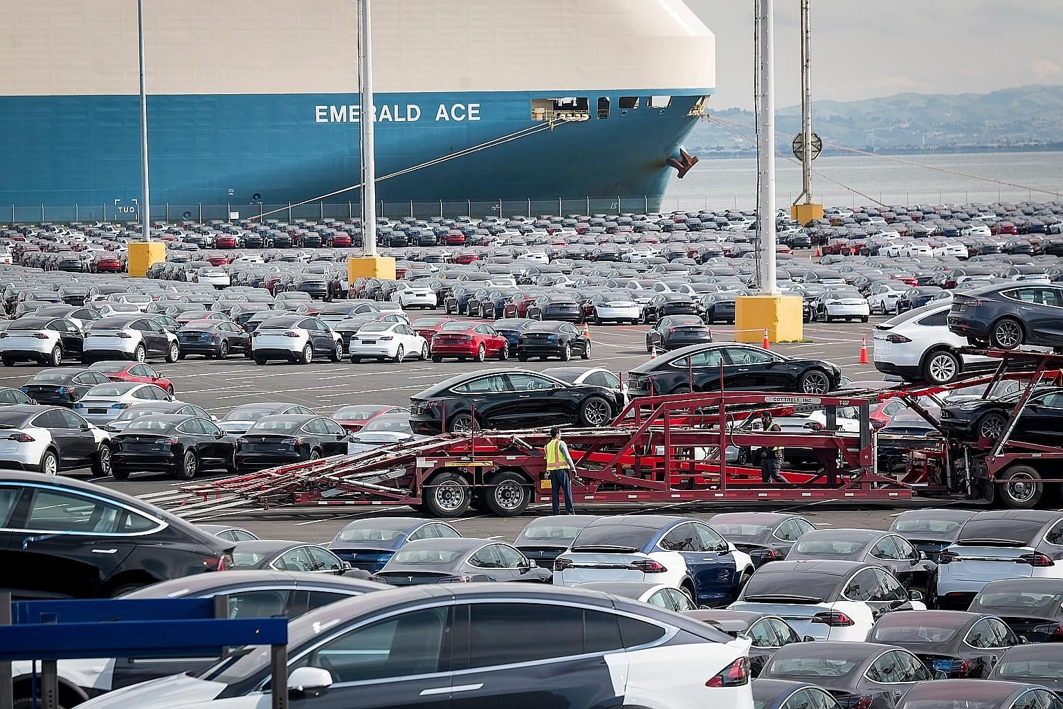 Tesla cars ready to be loaded onto vessels destined for China ahead of March 1, when a trade war truce between Beijing and Washington is set to end. There are hopeful signs for a resolution in the dispute, says the writer.