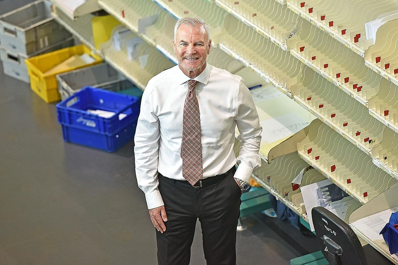 SingPost group chief executive Paul Coutts in the mail room at SingPost Centre. Mr Coutts said the surge in e-commerce volumes exposed weaknesses in SingPost's infrastructure and processes.