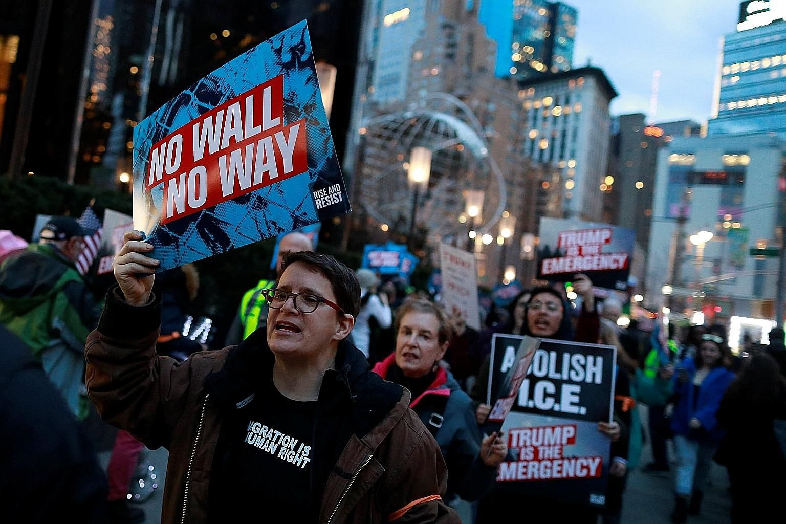 People gathering at Trump International Hotel & Tower in Manhattan on Friday to protest against US President Donald Trump's declaration of a national emergency to unlock funds for a border wall. Civil rights groups and Democrats have vowed to mount l