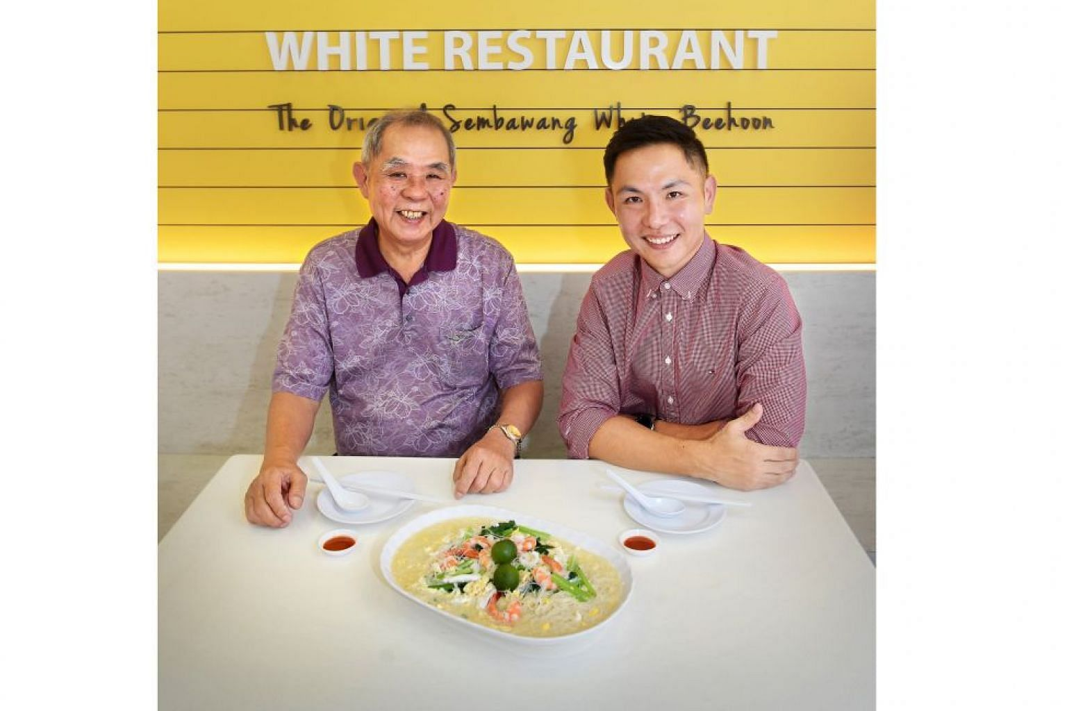 Mr Tay King Huak and his son Victor with their famous white beehoon dish.