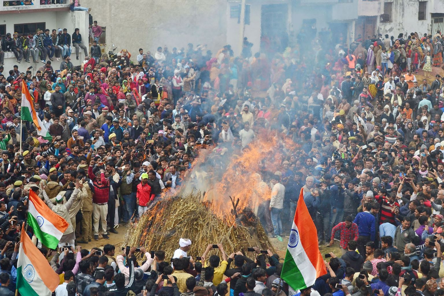 Mourners at the funeral for an Indian Central Reserve Police Force trooper in Agra yesterday. TV stations showed coffins wrapped in Indian flags being carried by thousands of people across their home towns after the bodies of the soldiers killed in t