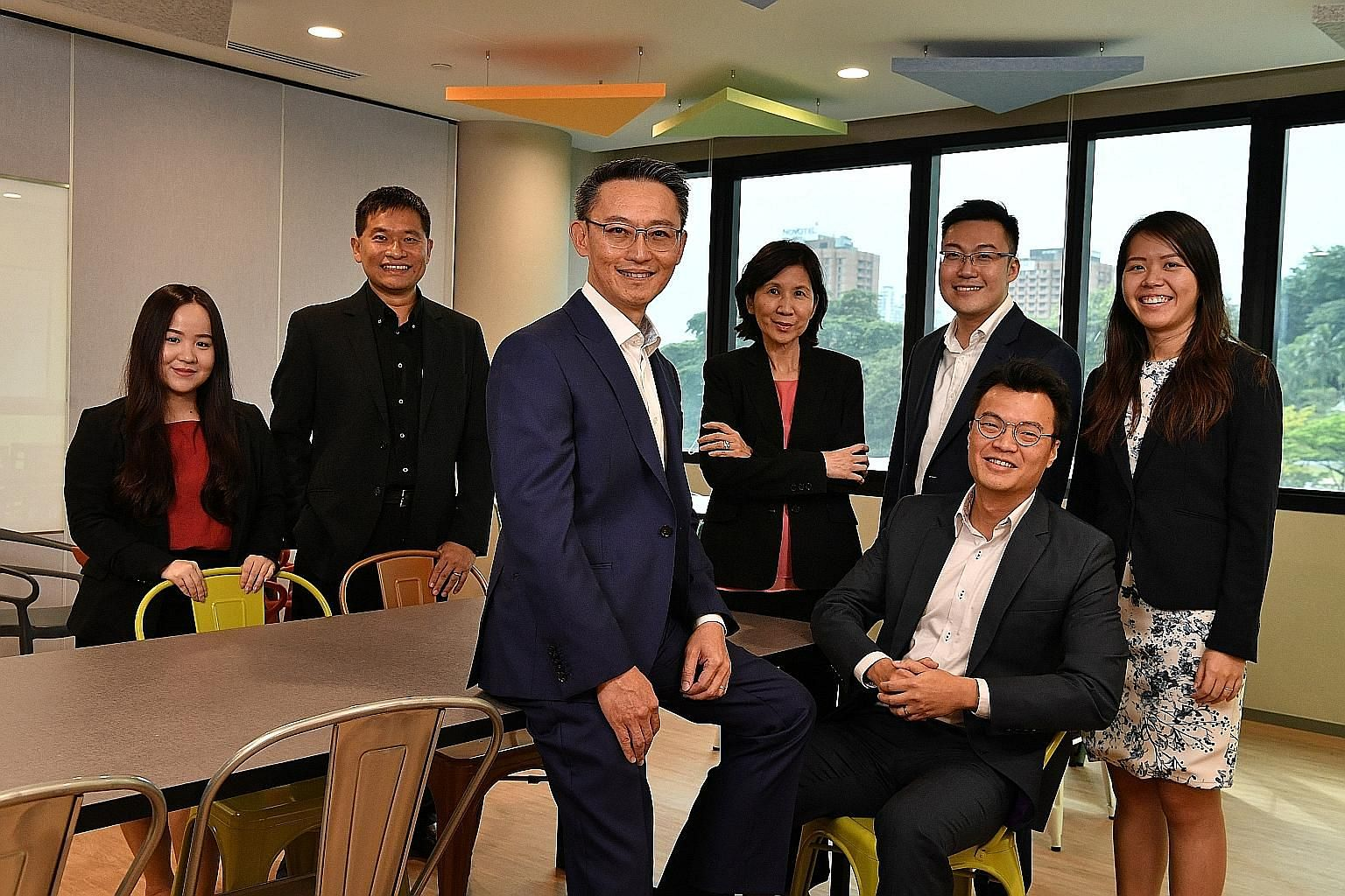 The MTI officials involved in bringing the FTA to fruition include (back row, from left) assistant director Gerbera Choo, deputy secretary (Trade) Luke Goh, director-general (Trade) Ng Bee Kim, director Chua Shun Loong and assistant director Judith H