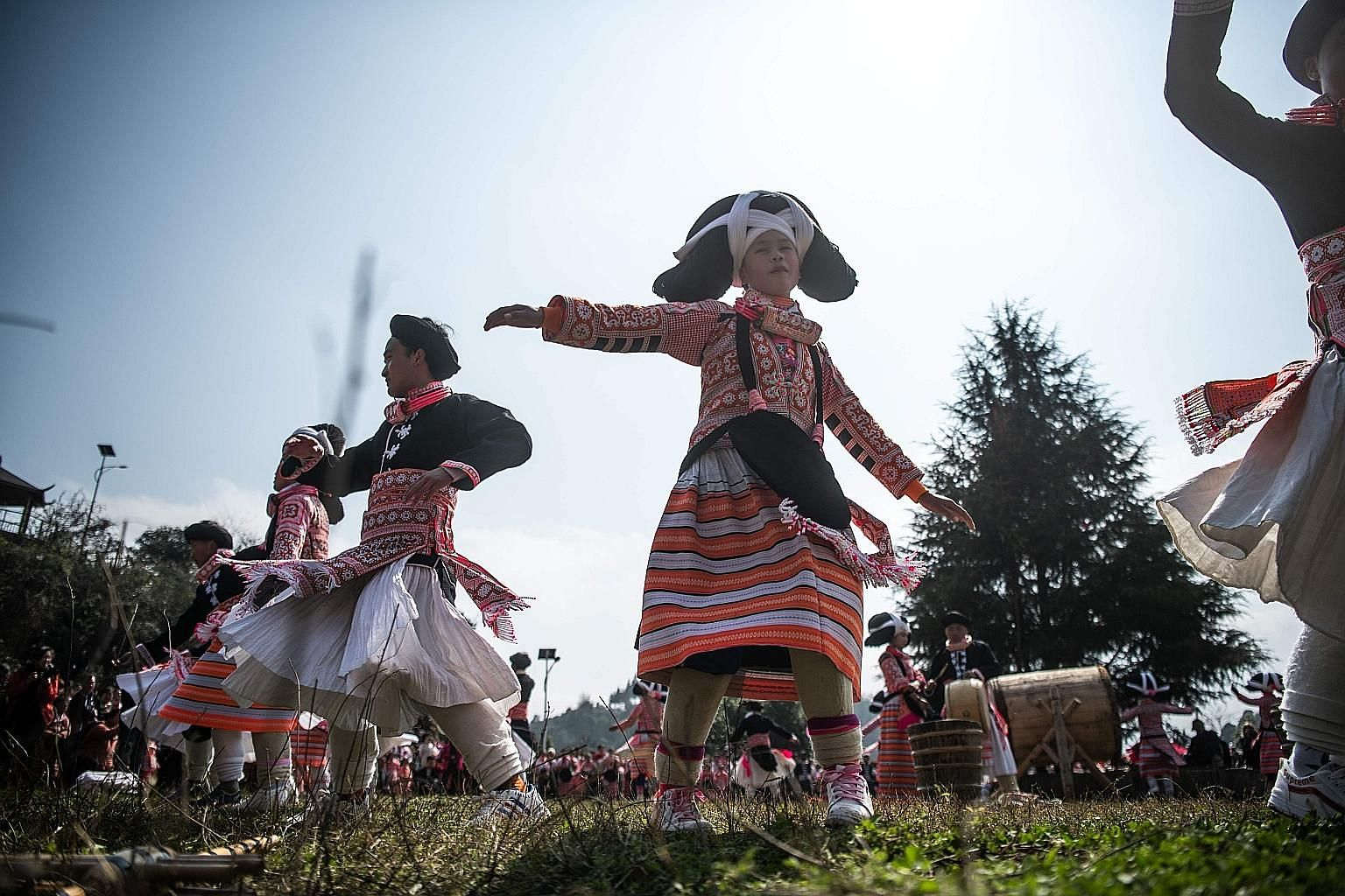 """Girls from the Long Horn Miao, a branch of the Miao ethnic minority group, taking part in the annual flower festival or """"Tiaohuajie"""" in the village of Longjia in China's Guizhou province to celebrate Chinese New Year. The dozens of dancers stood out"""