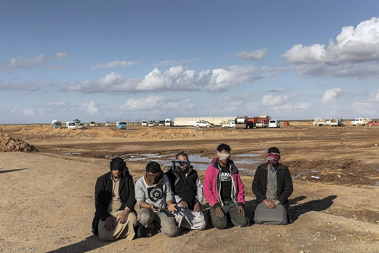 Suspected ISIS militants captured by the Syrian Democratic Forces (SDF) in Deir al-Zour province, Syria, last month. Once the US-led coalition declares it has taken all ISIS territories, the White House is expected to withdraw American troops. When t