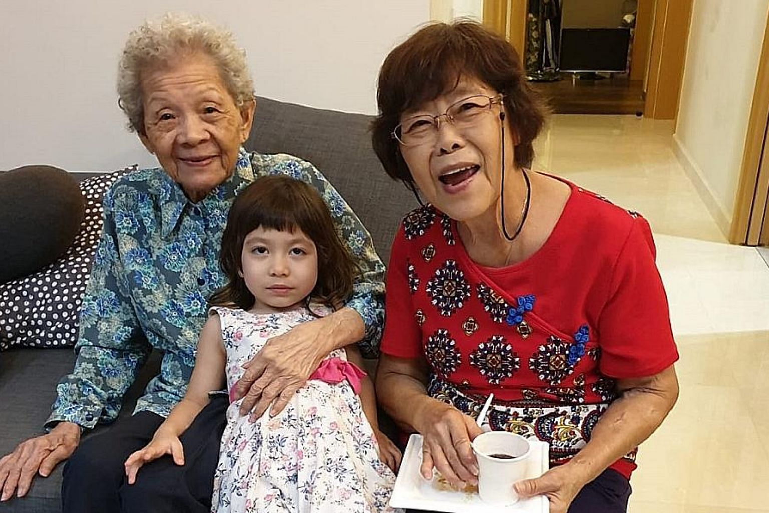 Madam Margaret Yeo with her mother, Madam Ng Guan Cheng, and her granddaughter, Alyx Raja Poh. Madam Yeo, who does not have space at home for a maid, believes the pilot scheme will be a big help, as long as the nursing home is nearby.