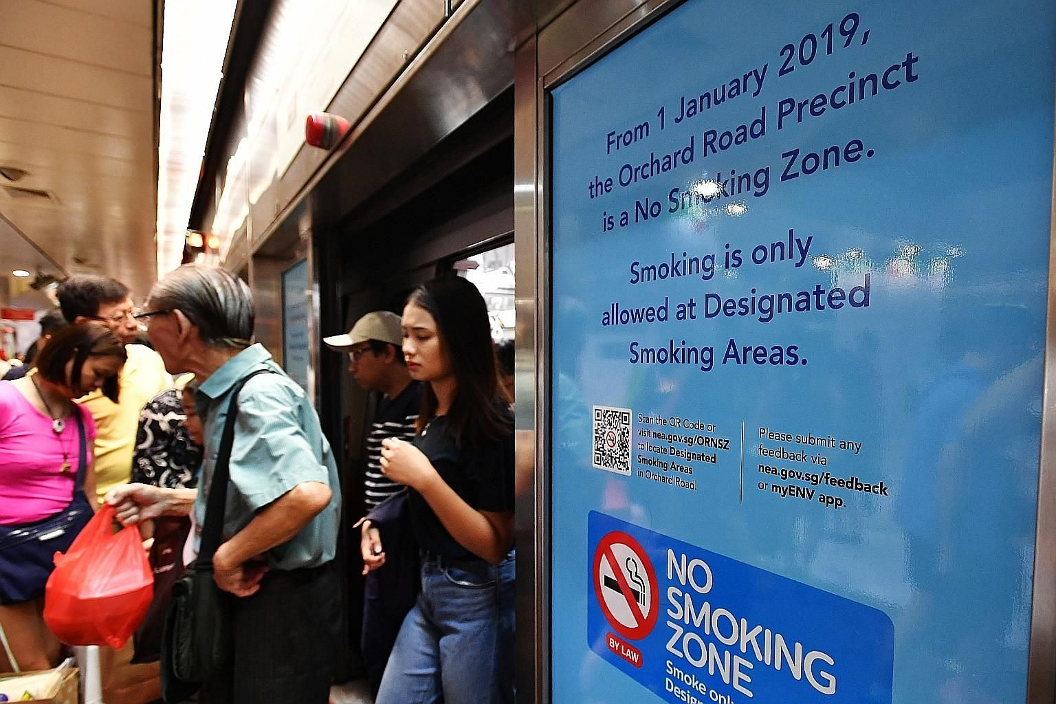 A poster at Orchard MRT station informing commuters of the smoking ban. The National Environment Agency said in its Facebook post that smokers are becoming more familiar with the locations of the 50 designated smoking zones along the shopping be