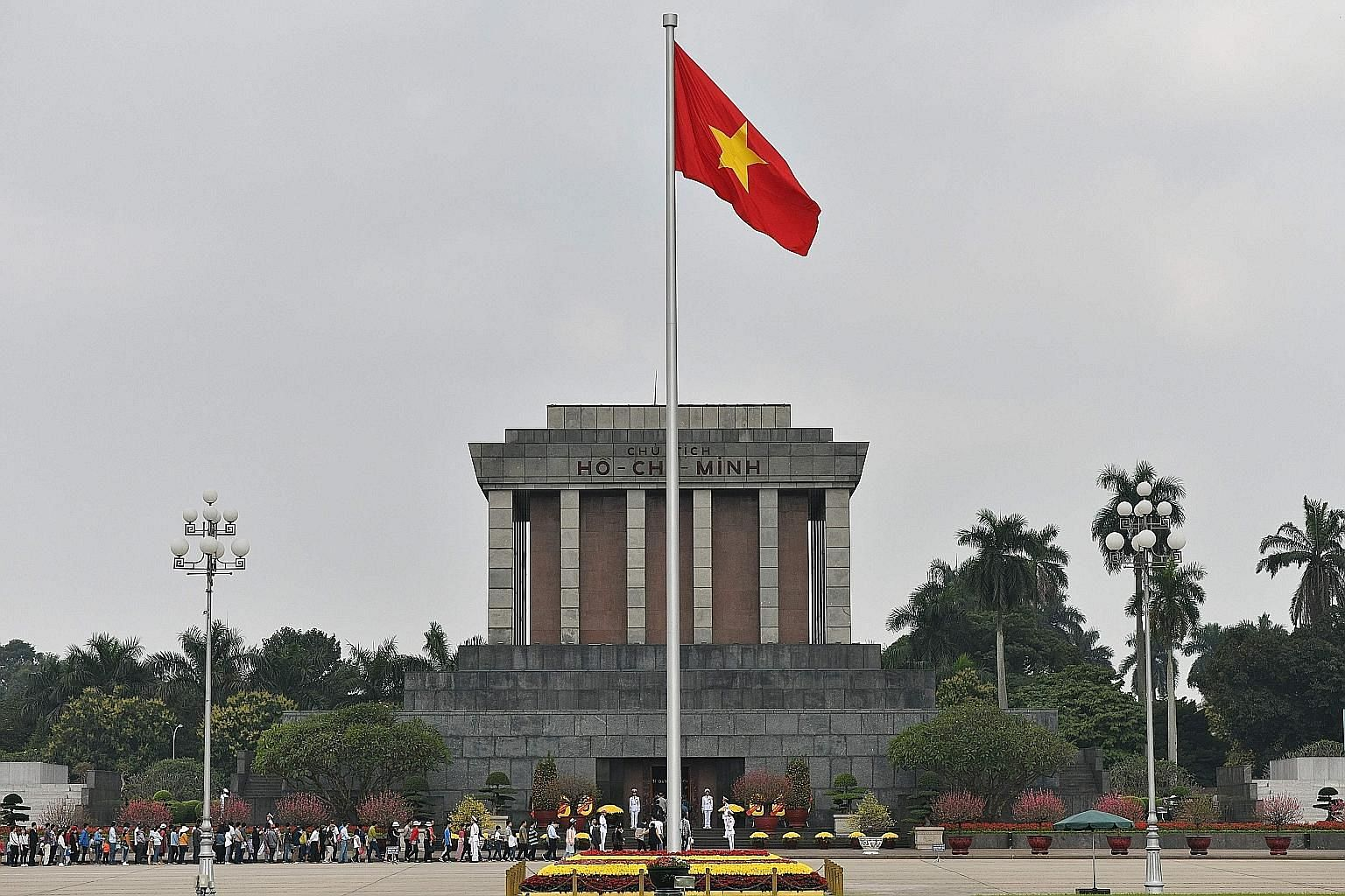 """Visitors lining up to enter the Ho Chi Minh Mausoleum in Hanoi. Vietnam is America's best """"poster-child"""" of how a former enemy can be an economic success story, without having to suffer a regime change, and enhance its strategic independence. The Vie"""