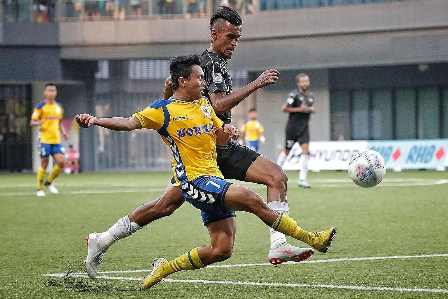 Tampines Rovers' Zulfadhmi Suzliman getting in a cross past Home United's Shakir Hamzah, now with Kedah, during last season's Singapore Premier League match at Our Tampines Hub.