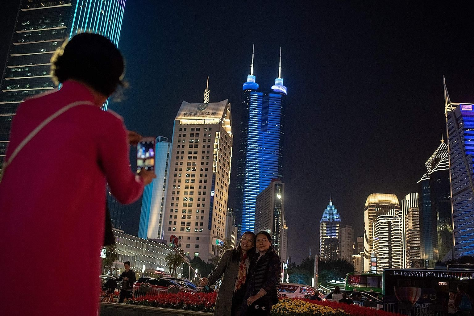 China's plan for its Greater Bay Area singles out four cities - Shenzhen (right), Hong Kong, Macau and Guangzhou - as key centres. Observers said the plan presents business opportunities, but could also mean more competition for Singapore.