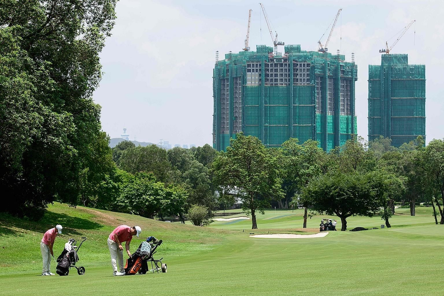 Golfers at Hong Kong's exclusive Fanling golf course tee off to views of construction as lawmakers seek to increase housing supply in the densely populated city. The government will take back 32ha of land, nearly a fifth, from the golf course as earl