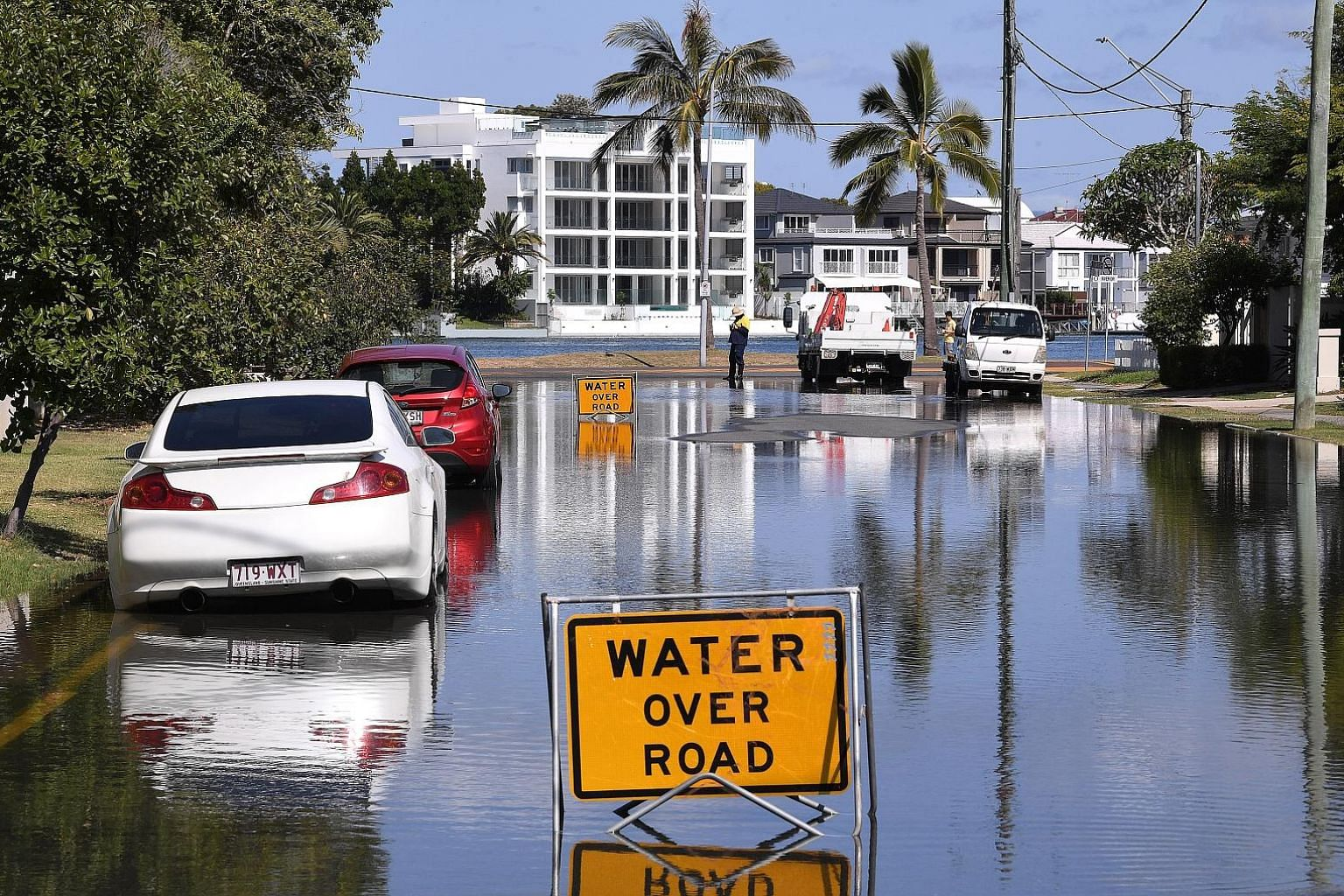 Flood waters covering a street on the Gold Coast in Queensland, Australia, yesterday as the brunt of Cyclone Oma approaches in the coming days.