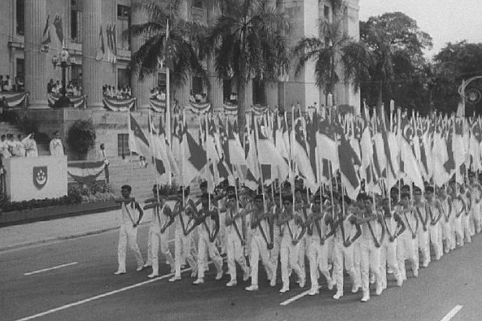 Singapore's first National Day Parade, at the Padang in 1966. In the early 1900s, people made a living growing and selling pineapples. Indian women carrying pails of latex on their heads in a rubber estate in the 1900s.