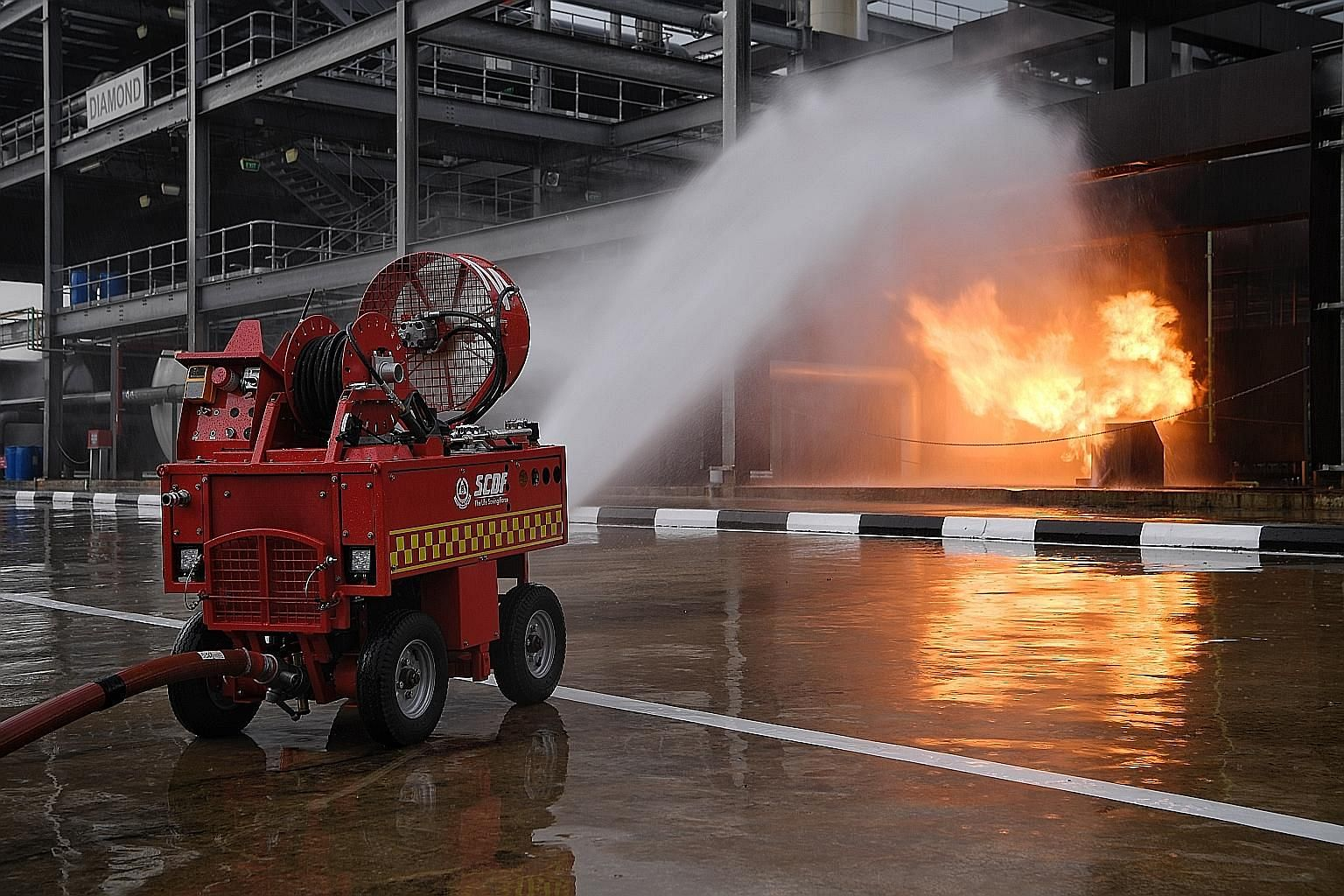 Some of the new technologies being explored by the Singapore Civil Defence Force include the pumper firefighting machine (above). The writer notes that the cost of counter-terrorist training and preparedness is rising, due in part to the higher costs
