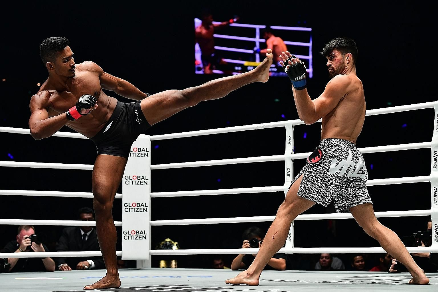 Singaporean Amir Khan aiming a kick at Costa Rican Ariel Sexton in One's lightweight Grand Prix quarter-finals last night. Sexton won the match by submission.