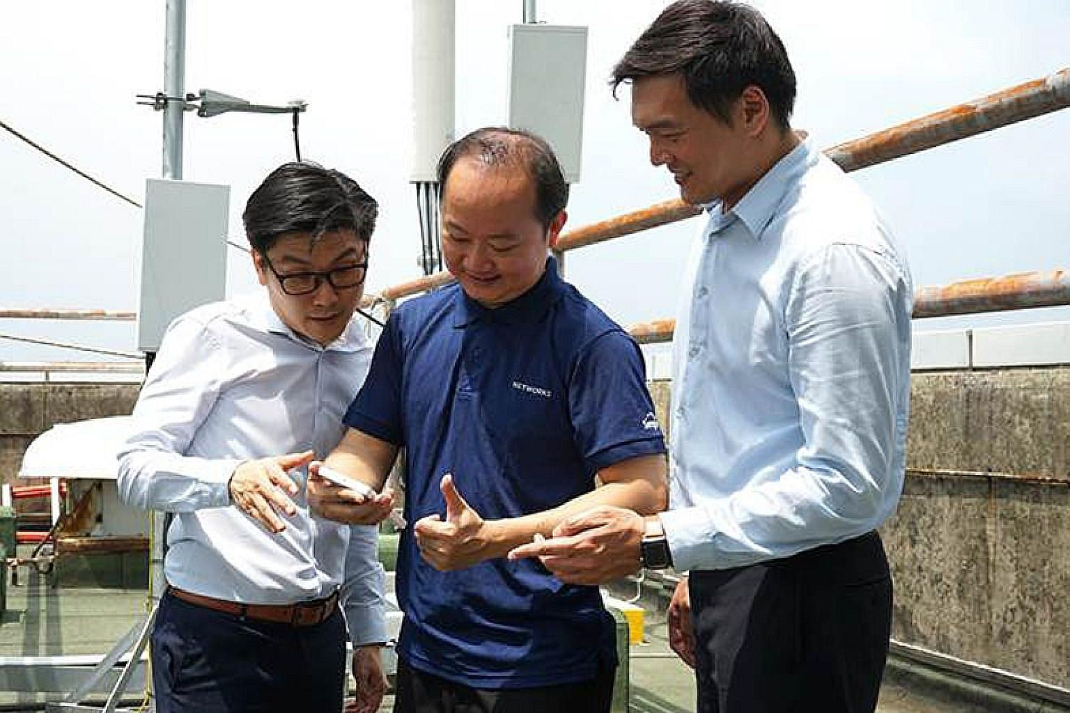 Singtel engineers in Singapore using the Oppo 5G test device during the three-minute 5G video call with their Optus counterparts in Sydney.
