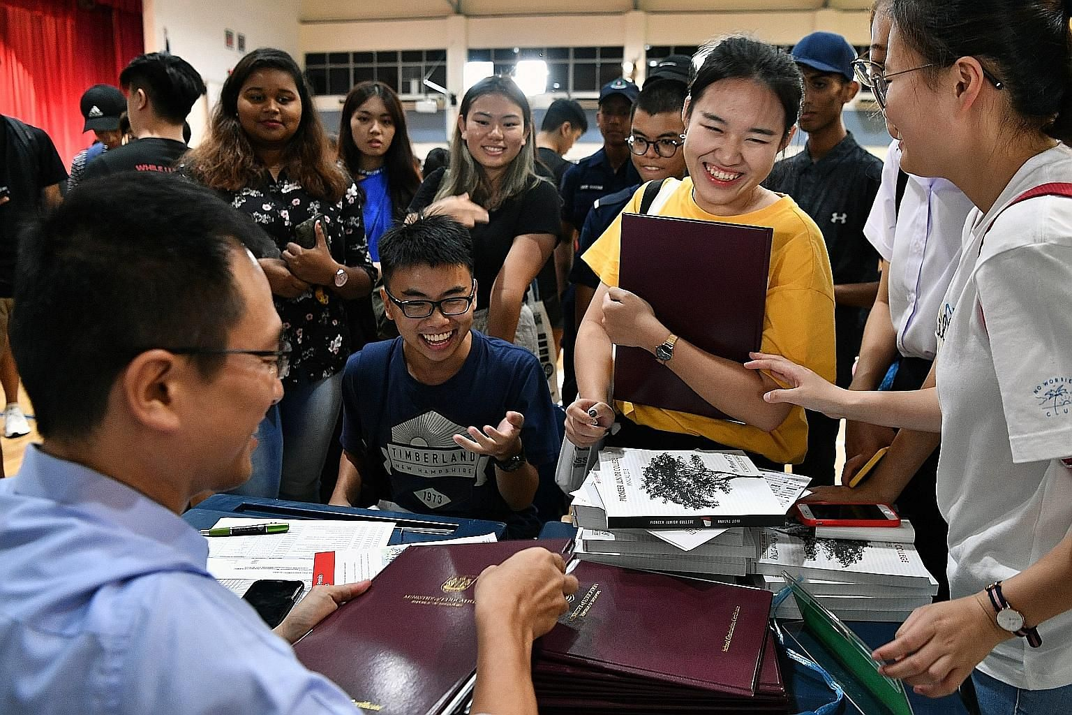 Students receiving their A-level results at Jurong Pioneer Junior College yesterday. Both Jurong JC and Pioneer JC - which merged into Jurong Pioneer JC - achieved better performances than in the previous year.