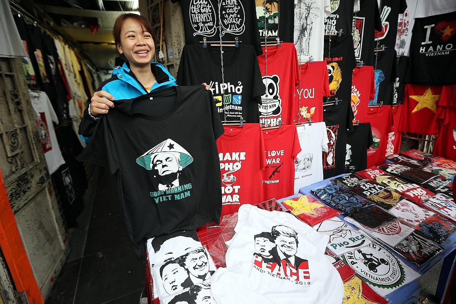 A bar in Hanoi has a cocktail commemorating the US-North Korea summit. T-shirts with the images of US President Donald Trump and North Korean leader Kim Jong Un at a store in Hanoi.