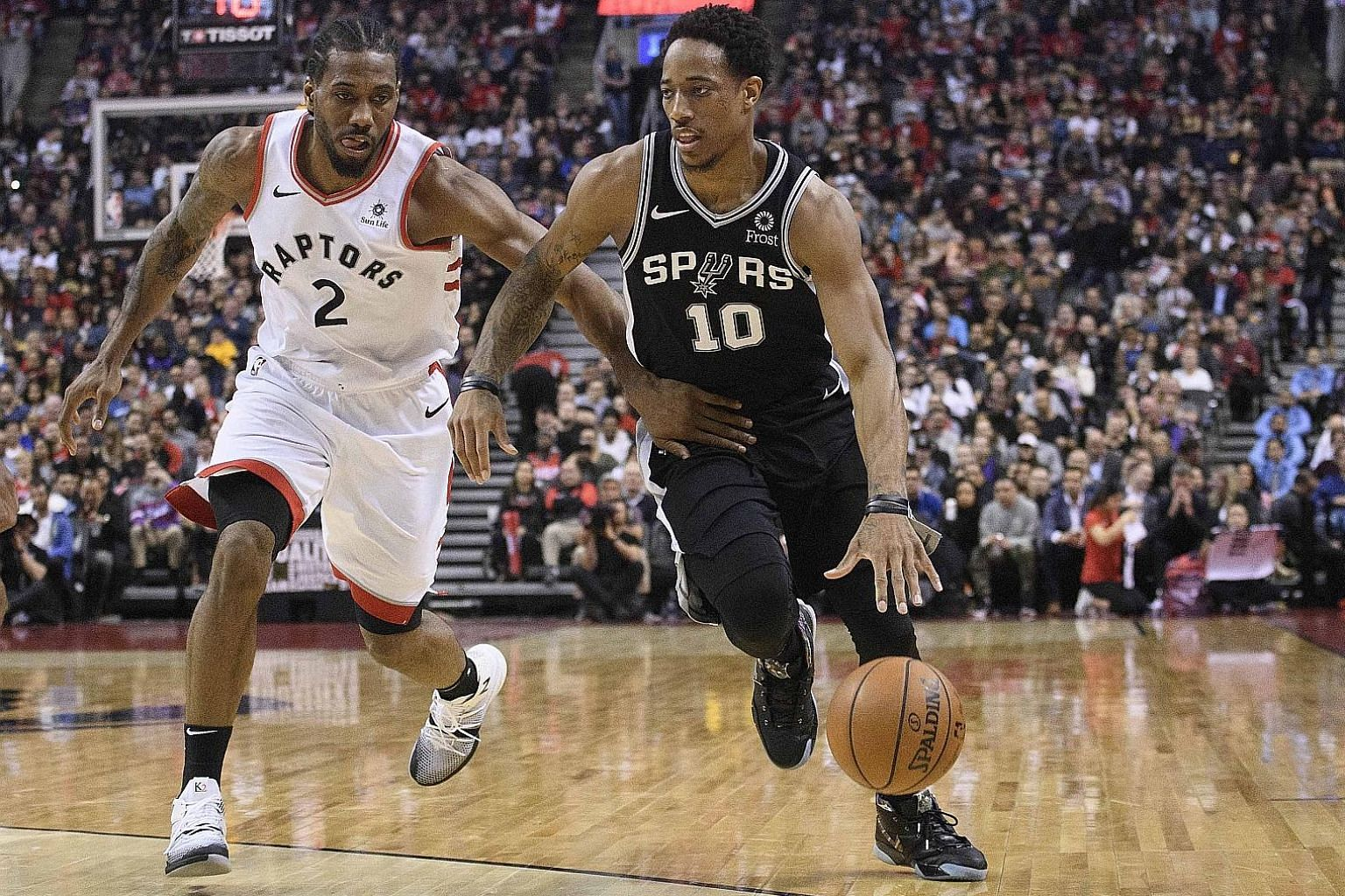 San Antonio Spurs guard DeMar DeRozan (right) shielding the ball from Toronto Raptors forward Kawhi Leonard during their National Basketball Association match at the Scotiabank Arena on Friday. Leonard scored the final four points in the Raptors' 120