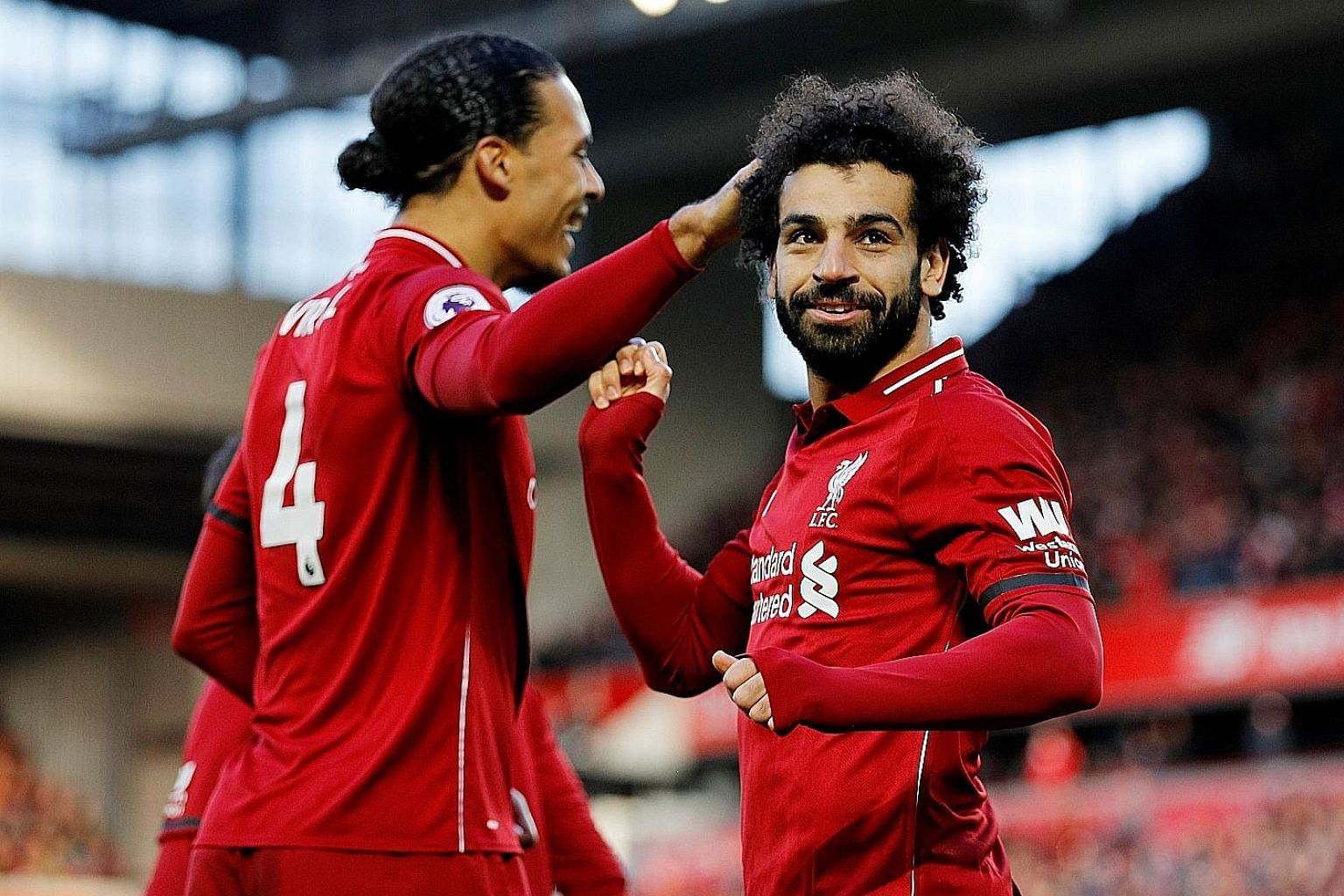 Leading striker Mohamed Salah (right) and dependable defender Virgil van Dijk will be the key men who can end Liverpool's league title drought this season.