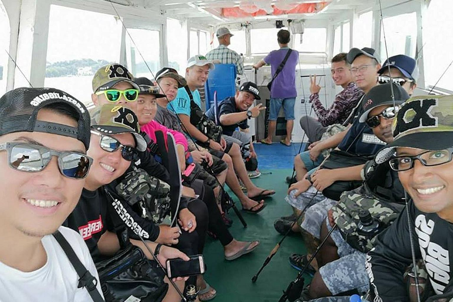 "Mr Billy Tan (above, left) on a fishing trip to Pulau Ubin with his friends. The fishing enthusiast who has been visiting Pulau Ubin once a week in the past four years said he was put off by new fences put up around the island, which once had ""many g"