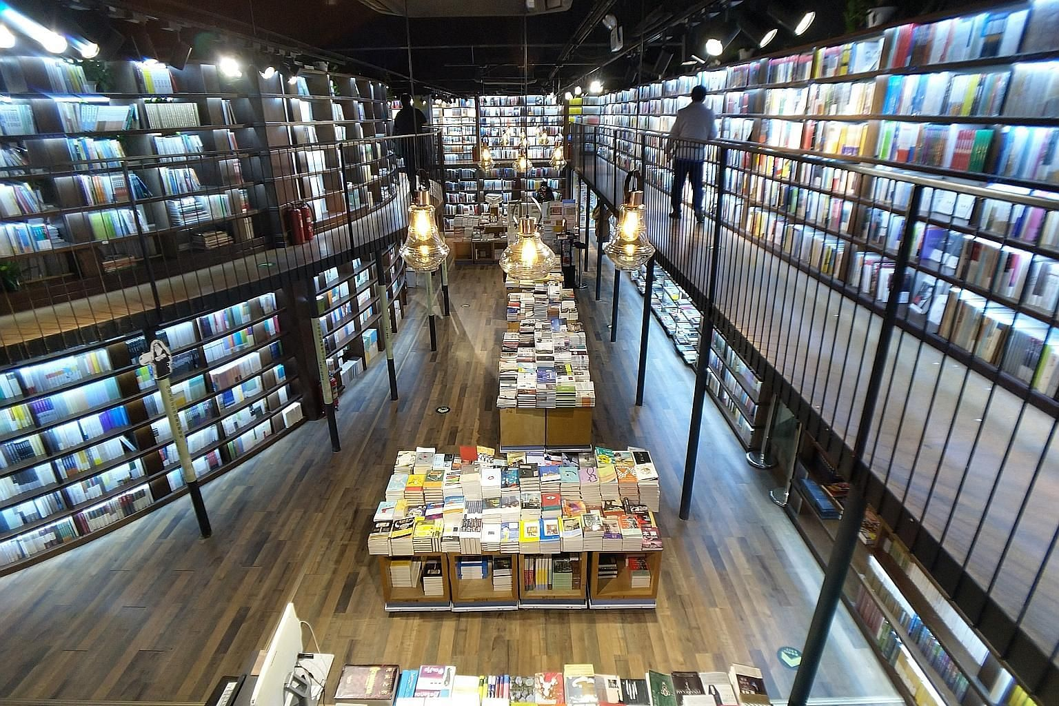 Sanlian Taofen, a 24-hour bookstore that opened in Beijing's Sanlitun neighbourhood last April, draws a steady late-night crowd through the week. Its attractions include an unusual layout of elevated walkways and two-storey bookshelves, as well as a