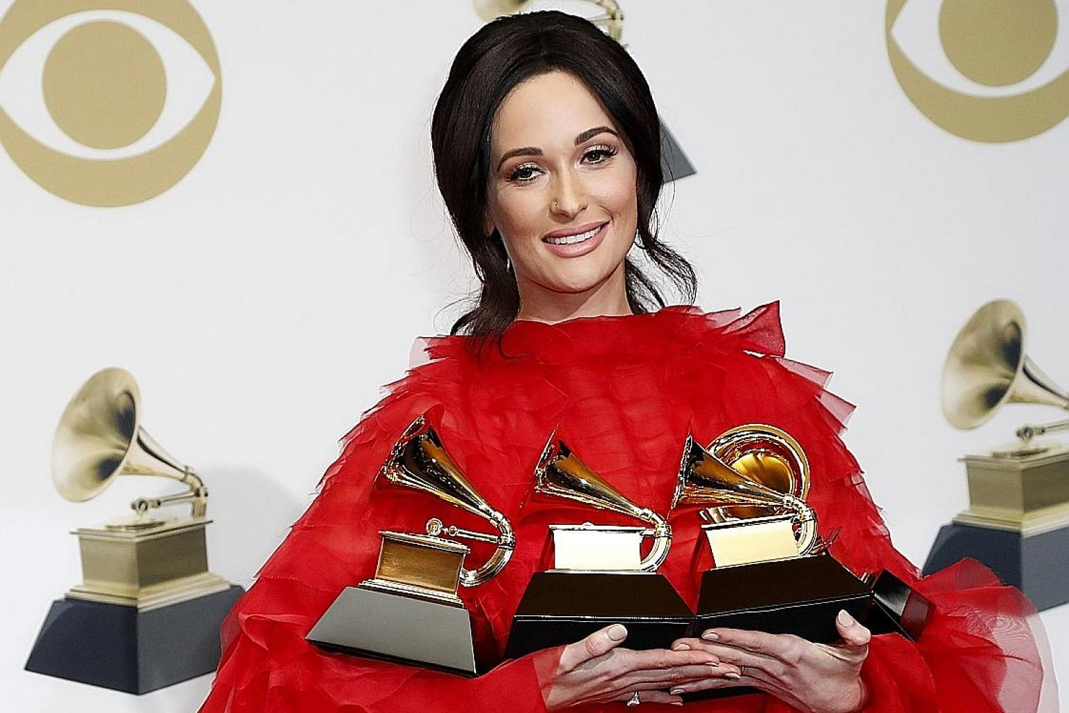 Kacey Musgraves' (above) Grammy wins included Album of the Year.