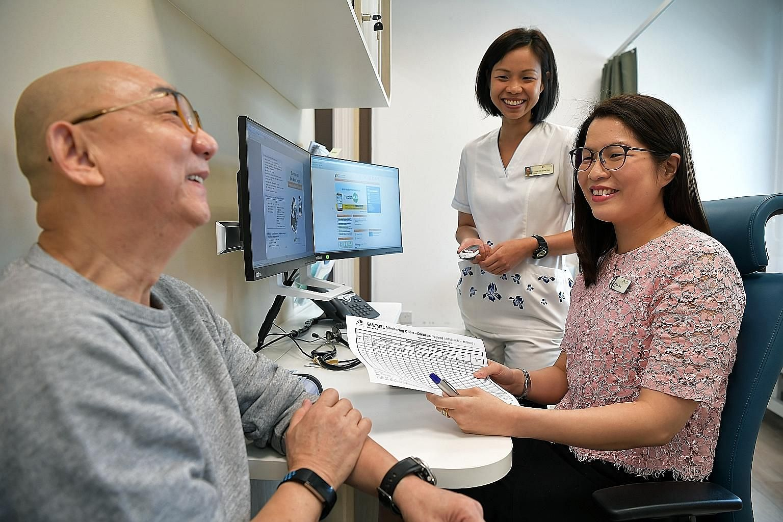 Mr George Then has seen his blood sugar level drop to a healthy level under the teamlet care programme with Dr Tricia Chang (seated) and care manager Evonne Oh.