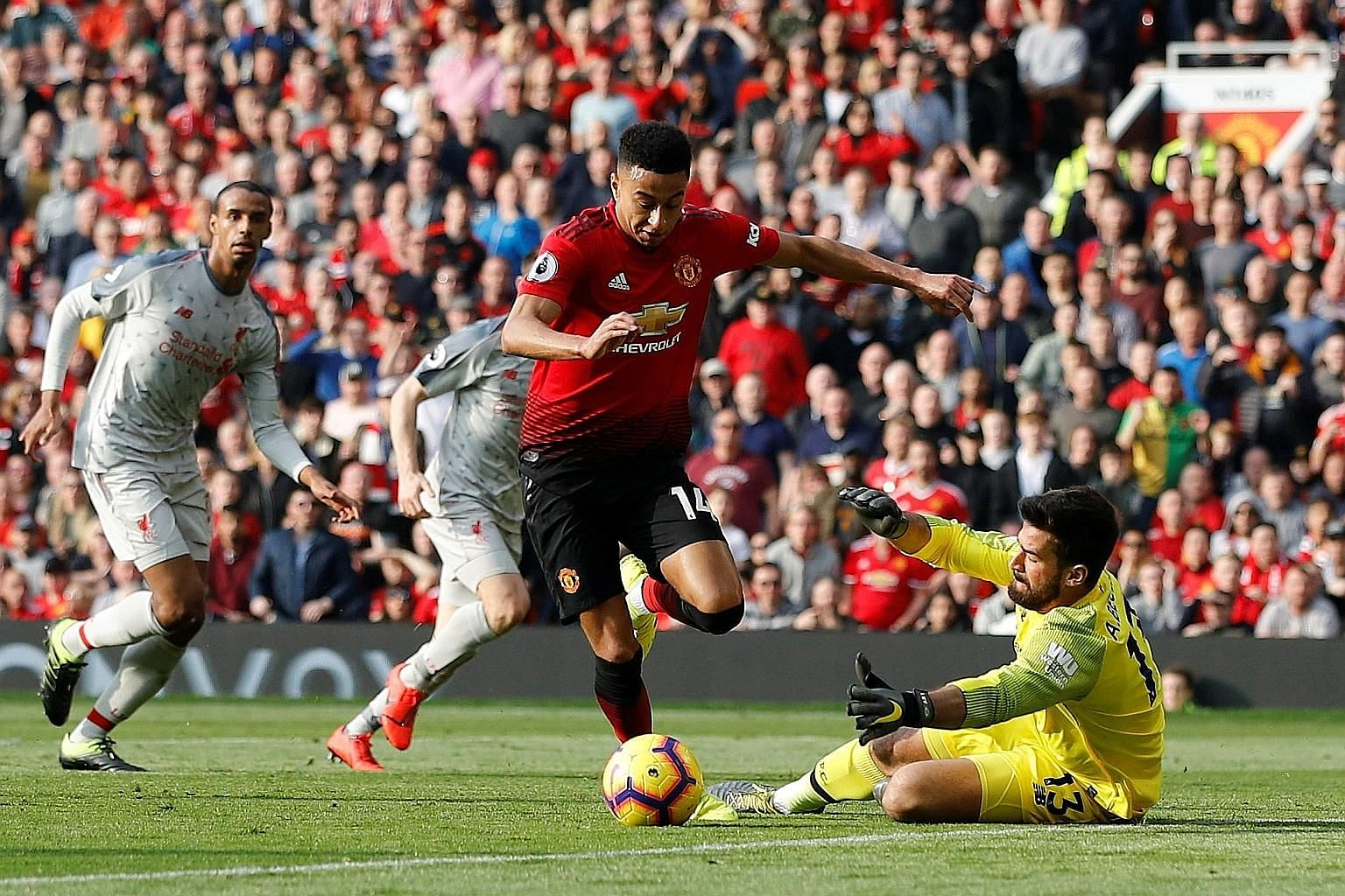 Jesse Lingard attempting to round Liverpool's Alisson, but was ultimately thwarted by the goalkeeper. It was Manchester United's clearest opportunity of note, as the two sides played out a goal-less stalemate yesterday.
