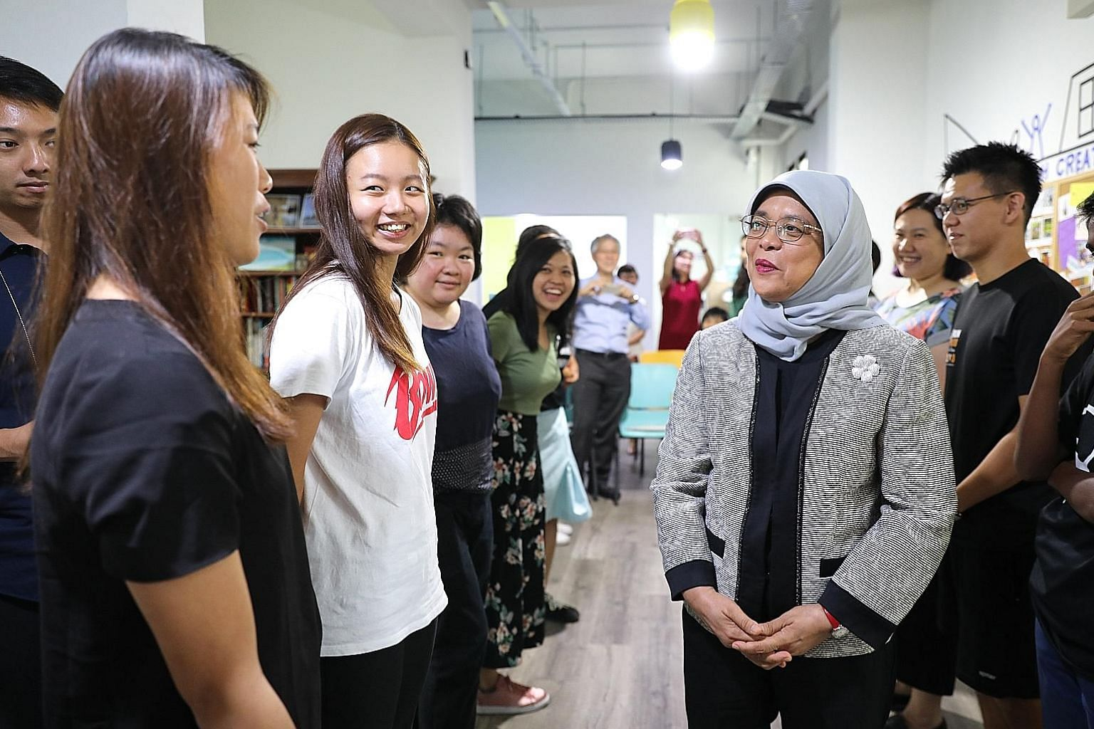 President Halimah Yacob speaking to participants of the forum theatre performance at the Singapore Association for Mental Health's Creative SAY centre in Woodlands yesterday.